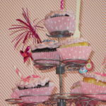 Pink and white diagonal stripped wall paper background with five chocolate and vanilla pink iced cupcakes in pink and white polka dotted wrappers