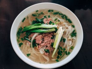 A close up of Pho bone broth soup
