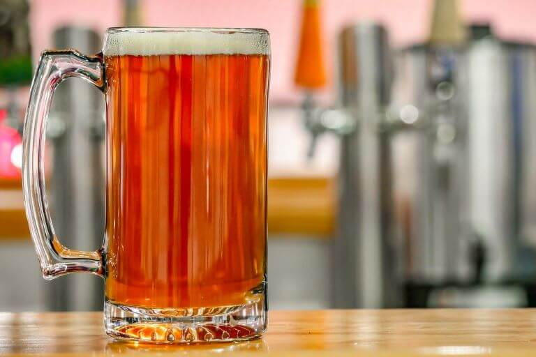 A mug of amber beer for an article about how beer is healthy for a post-workout recovery beverage