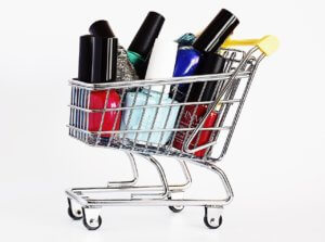 A shopping cart filled with a variety of colored nail polish for an article about new nail care applications and technology