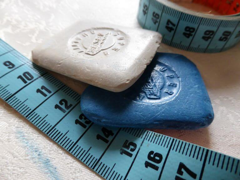 Tailor's white and blue chalk with tape measure for a lifestyle trend article about custom made, bespoke and personalized beauty, food and fashion products