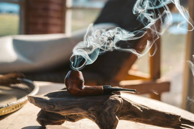A smoking pipe on a piece of drift for an article on tobacco fragrances and flavors