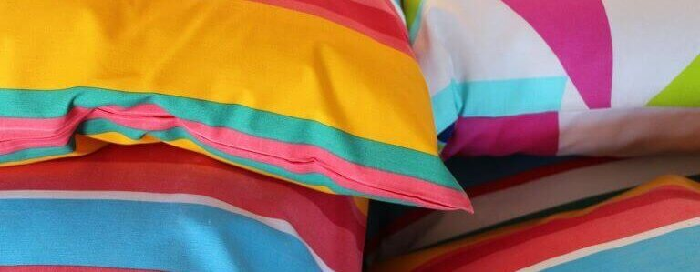 Four colorful soft striped pillows