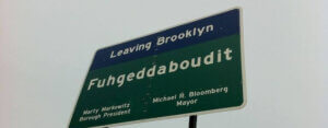 Fuhgeddaboudit Brooklyn sign looking up