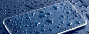 Wet purple smartphone covered in water droplets