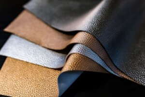 Brown and blue textured pieces of leather fabric for a trend article on vegan leather alternatives