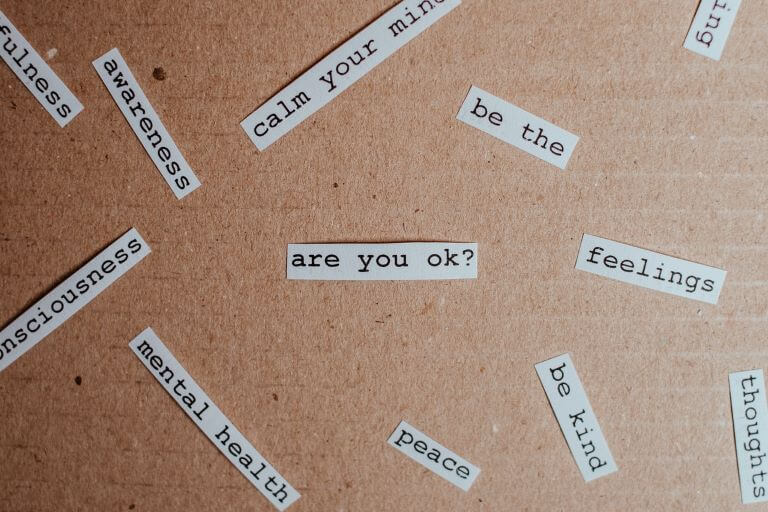 Words typed on paper for a trend article about mental health and well-being
